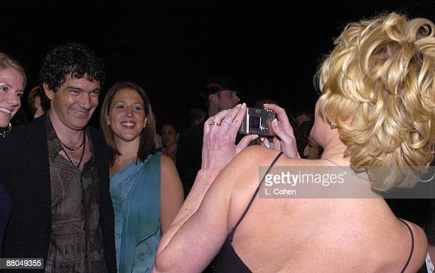 Melanie Griffith takes a picture of husband Antonio Bandera as he poses with fans