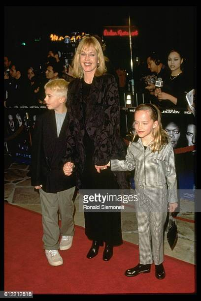Melanie Griffith with her children Dakota and Alexander at the premiere of 'Sphere' Mann's VT