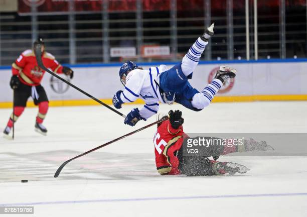 Melanie Jue of Kunlun Red Star WIH falls down during the 2017/2018 Canadian Women's Hockey League CWHL match between Kunlun Red Star WIH and Toronto...