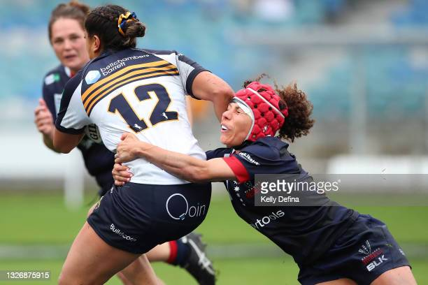 Melanie Kawa of the Rebels tackles Siokapesi Palu of the Brumbies during the Super W match between the Melbourne Rebels and the ACT Brumbies at Coffs...