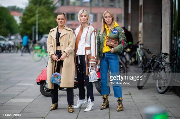 Melanie Kieback is seen wearing beige coat cropped top black jeans boots with snake print Louis Vuitton bag Lisa Hahnbueck is seen wearing sheer...