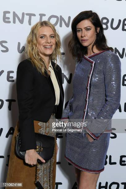 Melanie Laurent and Anna Mouglalis attend the Ruinart & David Shrigley - Unconventional Bubbles Exhibition photocall at Opera Bastille on March 05,...
