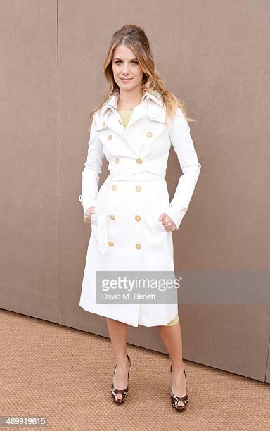 Melanie Laurent arrives at Burberry Womenswear Autumn/Winter 2014 at Kensington Gardens on February 17 2014 in London England