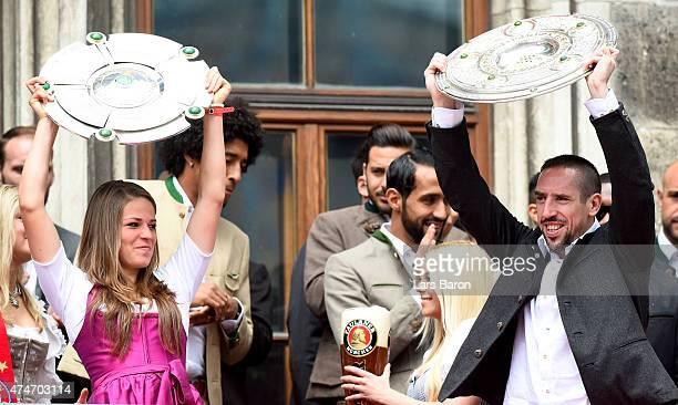 Melanie Leupold and Franck Ribery celebrate winning the Bundesliga at Marienplatz on May 24 2015 in Munich Germany