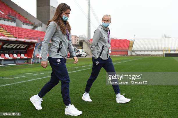 Melanie Leupolz and Pernille Harder of Chelsea walk out during a pitch inspection ahead of Chelsea FC Women's UEFA Women's Champions League Round of...