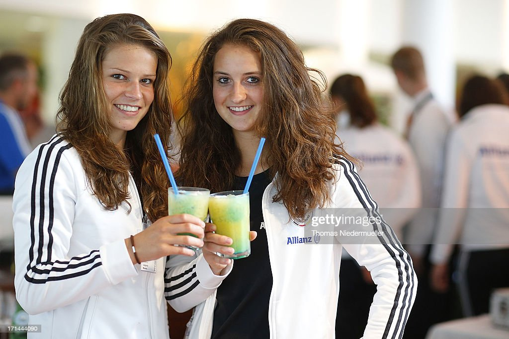 Melanie Leupolz (L) and Sara Daebritz (R) are seen during the DFB Team & Sponsors Cooking Event on June 24, 2013 in Munich, Germany.