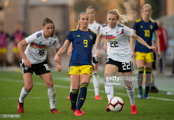 Melanie Leupolz and Turid Knaak of Germany and Kosovare Asllani of Sweden during the Algarve Cup quarterfinal match between Gernany Women and Sweden...