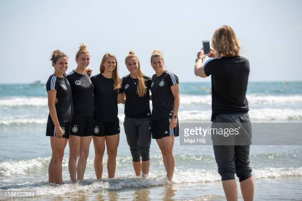 Melanie Leupolz Johanna Elsig Klara Buehl Giulia Gwinn and Verena Schweers of Germany pose for a photo as team of Germany visits the beach on June 15...