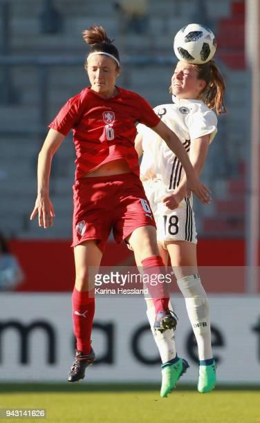 Melanie Leupolz of Germany and Eva Bartonova of Czech Republic jump for a header during the 2019 FIFA Womens World Championship Qualifier match...