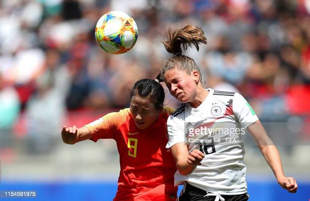 Melanie Leupolz of Germany and Li Yang of China jump for the ball during the 2019 FIFA Women's World Cup France group B match between Germany and...