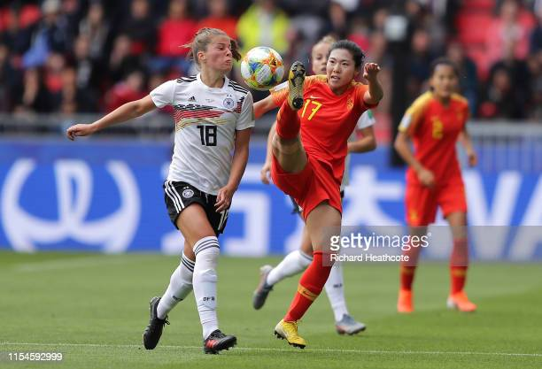 Melanie Leupolz of Germany battles for possession with Yasha Gu of China during the 2019 FIFA Women's World Cup France group B match between Germany...
