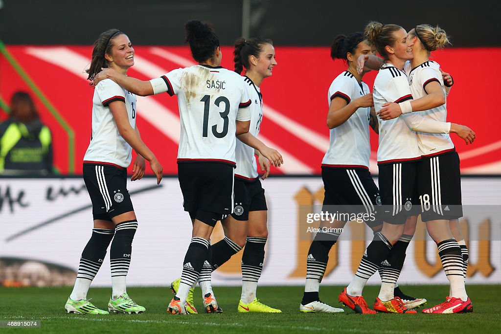 Melanie Leupolz (L) of Germany celebrates his team's third goal with team mates during the Women's International Friendly match between Germany and Brazil at Trolli-Arena on April 8, 2015 in Fuerth, Germany.