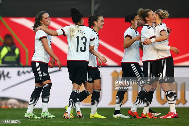 Melanie Leupolz of Germany celebrates his team's third goal with team mates during the Women's International Friendly match between Germany and...