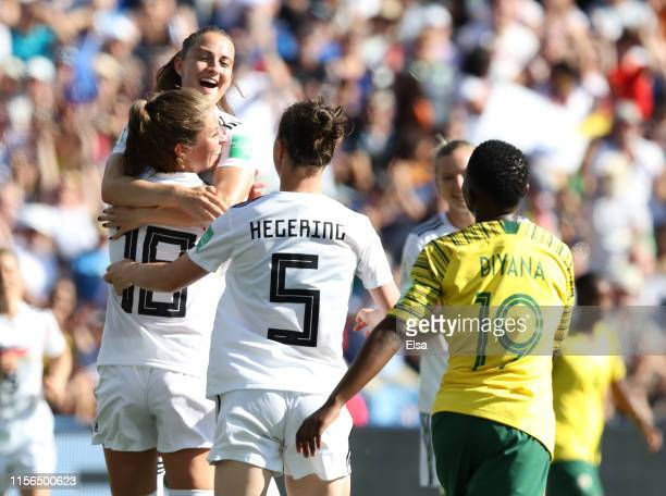 Melanie Leupolz of Germany celebrates with teammates after scoring her team's first goal during the 2019 FIFA Women's World Cup France group B match...