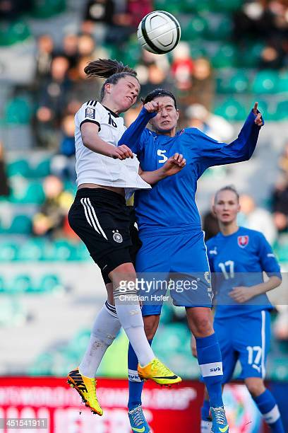 Melanie Leupolz of Germany competes for the ball with Alexandra Biroova of Slovakia during the FIFA Women's World Cup 2015 Qualifier between Slovakia...
