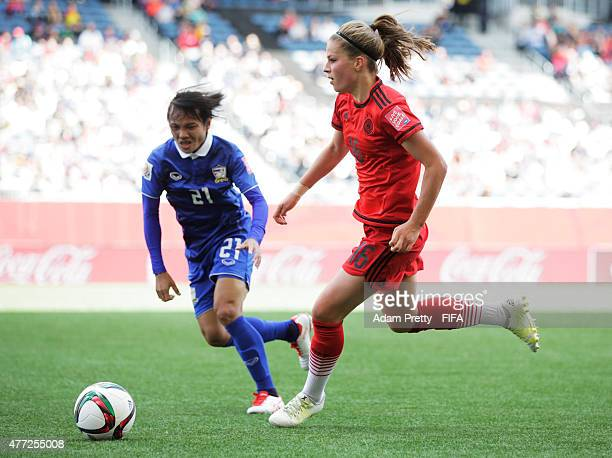 Melanie Leupolz of Germany is challenged by Kanjana SungNgoen of Thailand during the FIFA Women's World Cup 2015 Group B match between Thailand and...