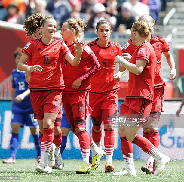 Melanie Leupolz of Germany is congratulated after scoring a goal during the FIFA Women's World Cup 2015 Group B match between Thailand and Germany at...