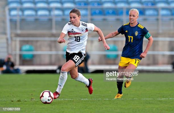 Melanie Leupolz of Germany Women battles for the ball with Caroline Seger of Sweden Women during the Germany v Sweden Algarve Cup match at Algarve...