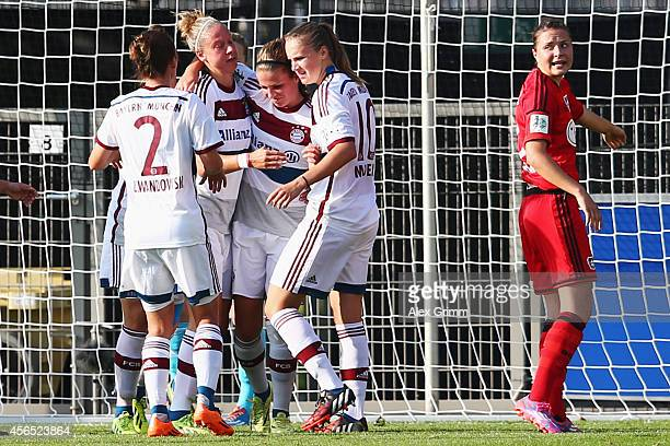 Melanie Leupolz of Muenchen celebrates her team's first goal with team mates during the Allianz FrauenBundesliga match between Bayer 04 Leverkusen...