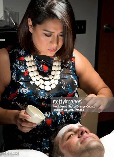 Melanie Mari left owner of BareSkin Studio in Laguna Hills applies a skin resurfacing cleanser to the face of Brea real estate agent Jonathan McCarty...
