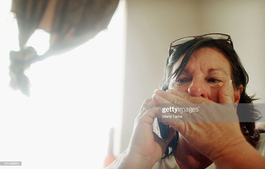 Melanie Martinez becomes emotional while speaking on the phone about a missing family pet while in her daughter Kala's one bedroom apartment on September 7, 2012 in Chalmette, Louisiana. Melanie, along with her husband and mother, are staying in Kala's apartment for the time being after their home in Braithwaite flooded during Hurricane Isaac. It was the fifth home Martinez has had destroyed due to hurricanes in Louisiana