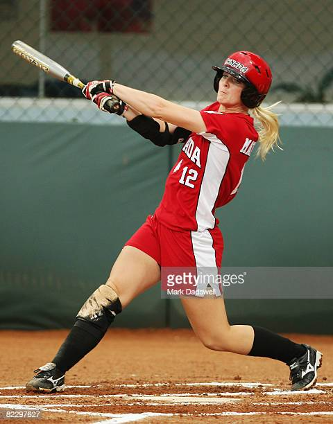 Melanie Matthews of Canada swings at a pitch against the United States during their preliminary softball game at the Fengtai Softball Field during...