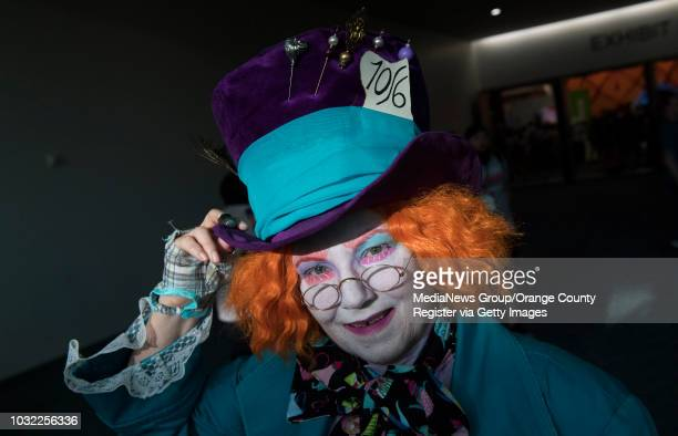 Melanie McGrew of La Mesa came dressed as the Mad Hatter during the first day of ComicCon International at the San Diego Convention Center in San...