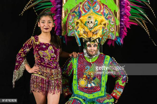 Melanie Michel Perez and Alfredo Alvarez pose in their costumes for the carnival in Tlaxcala Mexico on February 13 2018 The satirical costumes and...