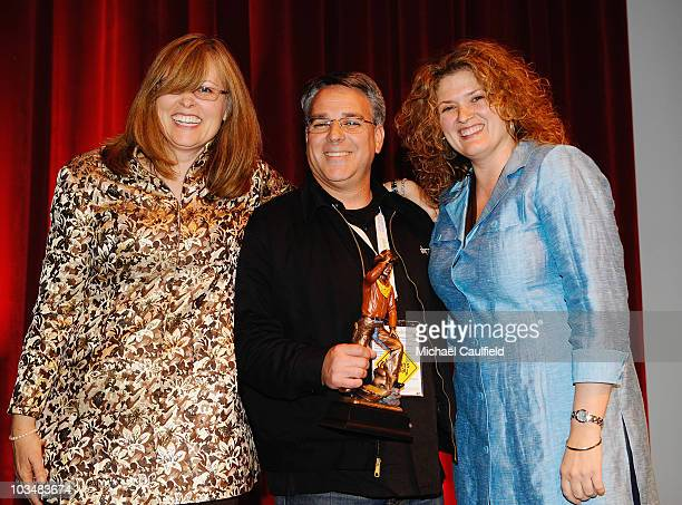 Melanie Miller director Craig Saavedra with his award and Cevin Cathell pose on stage at the Awards Ceremony during the 5th annual Jackson Hole Film...
