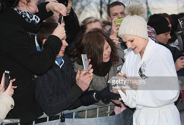 Melanie Mueller winner of the German television program Dschjungelcamp gives autographs to fans after her run in the 2014 Naken Sledding World...