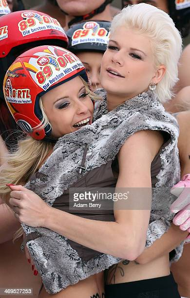 Melanie Mueller winner of the German television program Dschjungelcamp poses with Mia Julia title holder prior to their runs in the 2014 Naken...