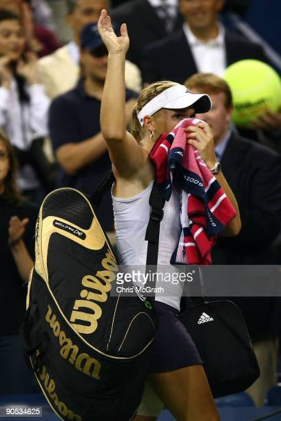 Melanie Oudin of the United States walks off court after being defeated by Caroline Wozniacki of Denmark during day ten of the 2009 US Open at the...