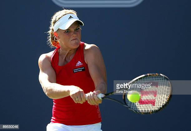 Melanie Oudin of the USA returns a shot to Marion Bartoli of France during their match on Day 4 of the Bank of the West Classic at Stanford...