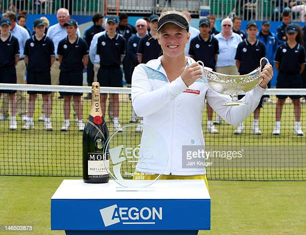 Melanie Oudin of USA celebrates with the Maud Watson Trophy after victory over Jelena Jancovic of Serbia during the singles final match on day eight...