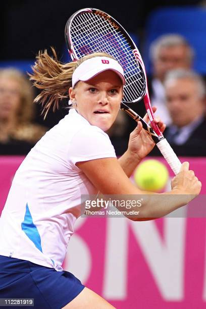 Melanie Oudin of USA returns the ball to Andrea Petkovic of Germany during the second day of the Fed Cup match between Germany and United States at...