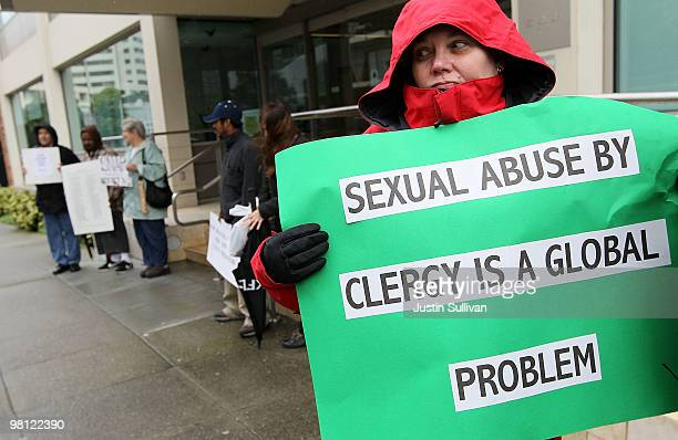 Melanie Sakoda holds a sign as she participates in a demonstration with members of the group SNAP the Survivors Network of those Abused by Priests...