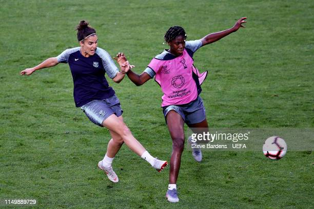 Melanie Serrano of FC Barcelona Women is challenged by teammate Asisat Oshoala in a training session during previews ahead of the UEFA Women's...