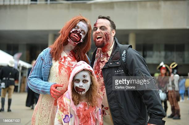 TORONTO ON OCTOBER 26 Melanie Smith Ryan Smith and Emma Jade Smith pose for a photograph at Nathan Phillips Square during Toronto's Zombie Walk on...
