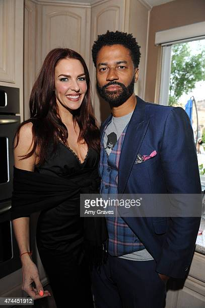 Melanie Specht and Eric Benet attend the Mission Save Her's Private Party Hosted by Eric Benet and Reggie Benjamin at a Private Residence on May 22...