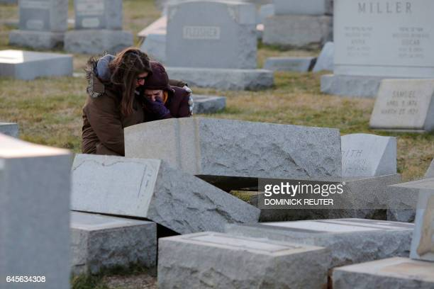 Melanie Steinhardt comforts Becca Richman at the Jewish Mount Carmel Cemetery February 26 in Philadelphia PA Police say more than 100 tombstones were...