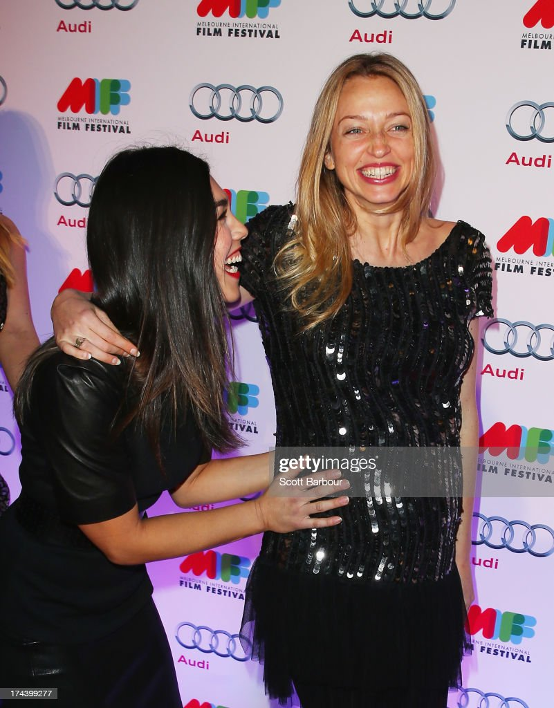 Melanie Vallejo touches a pregnant Zoe Tuckwell-Smith from Winners & Losers on the stomach as they arrive at the Australian premiere of 'I'm So Excited' on opening night of the Melbourn International Film Festival at Hamer Hall on July 25, 2013 in Melbourne, Australia.