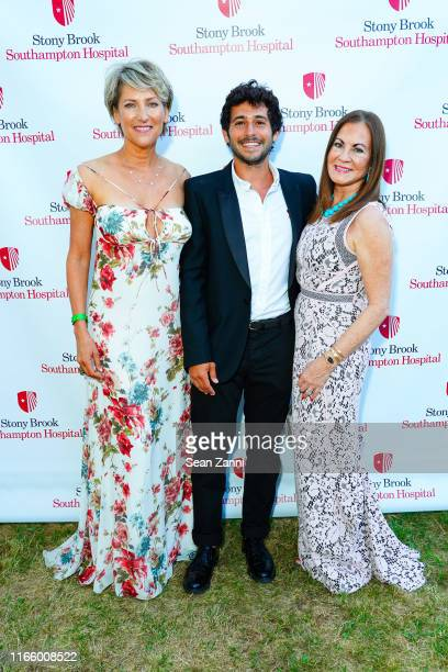 Melanie Wambold Jesse Warren and Judith Nathan attend the Annual Summer Party Benefiting Stony Brook Southampton Hospital on August 03 2019 in...