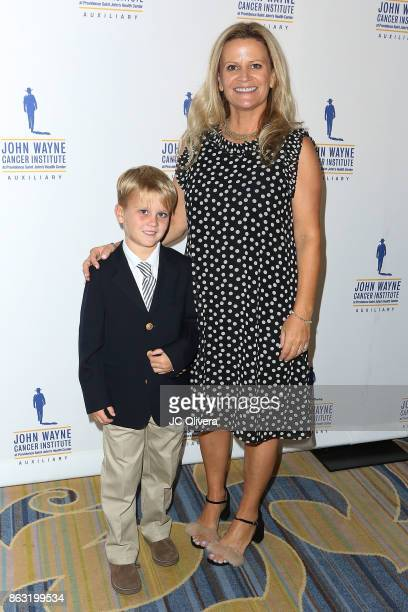 Melanie Wayne and son Charles Bush attend John Wayne Cancer Institute Auxiliary honoring Sheryl A Ross MD with The Angel Award at the Beverly...