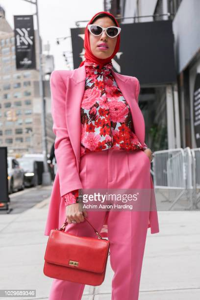 Melanie Zedan is seen wearing a pink Zara suit with a floral Zara top and a red hijab from Haute Hijab on the street during New York Fashion Week on...