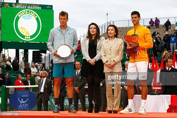 MelanieAntoinette de Massy and Baronne ElizabethAnn de Massy pose with Novak Djokovic of Serbia with the winners trophy next to runner up Tomas...