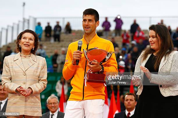 MelanieAntoinette de Massy and Baronne ElizabethAnn de Massy stand with Novak Djokovic of Serbia after he defeated Tomas Berdych of Czech Republic in...