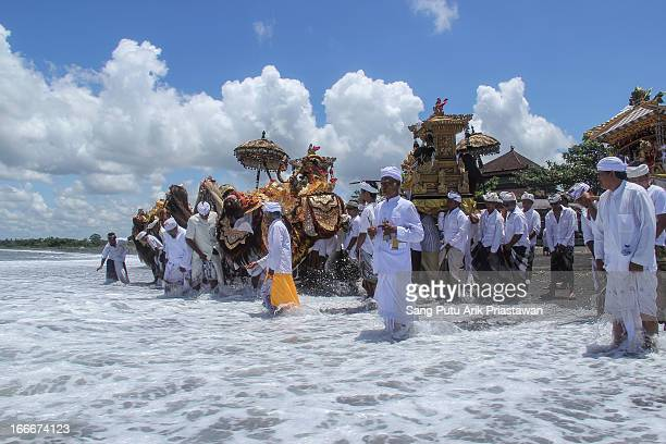 Melasti tradition is a tradition that hindu people do before silent day . Peope go to beach or river to purify their souls.