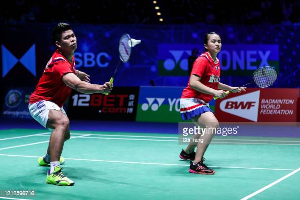 Melati Daeva Oktavianti and Praveen Jordan of Indonesia compete in the Mixed Double final match against Dechapol Puavaranukroh and Sapsiree...