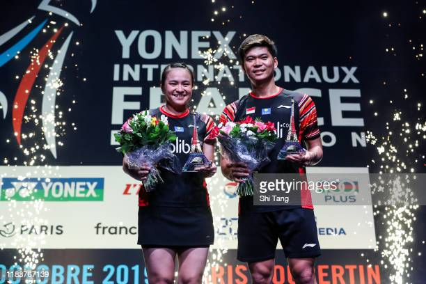 Melati Daeva Oktavianti and Praveen Jordan of Indonesia pose with their trophies after the Mixed Double final match against Zheng Siwei and Huang...