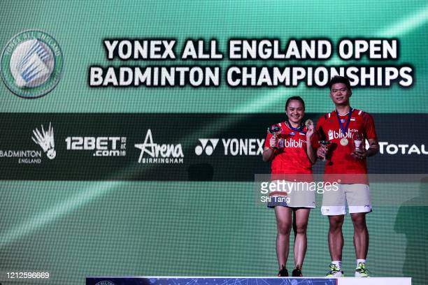 Melati Daeva Oktavianti and Praveen Jordan of Indonesia pose with their trophies after the Mixed Double final match against Dechapol Puavaranukroh...